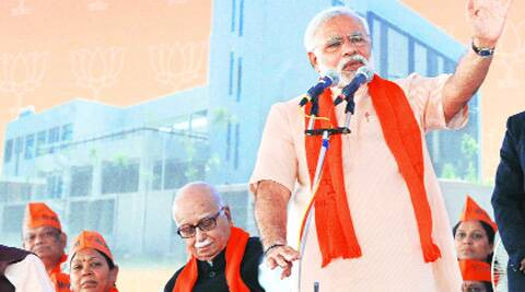 Modi and L K Advani at the Gandhinagar function. (Express photo)