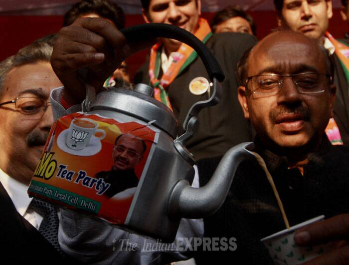 BJP members serve tea to the people at the 'NaMo Tea Party'. (IE Photo: Prem Nath Pandey)