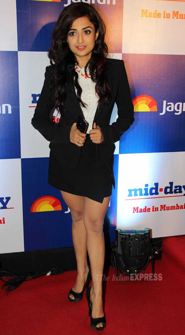 Singer turned actress Monali Thakur looks petite in formal blazer and skirt. Monali added colour to her look with a clunky red neck piece. We like! (Photo: Varinder Chawla)