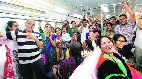 Passengers enjoying their first ride in monorail in Mumbai.