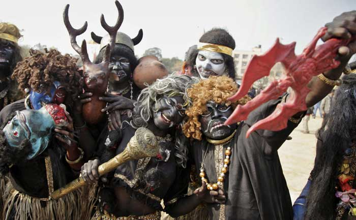 Hindu devotees dressed as demons participate in a procession on the eve of Shivratri festival, in Jammu. (AP)