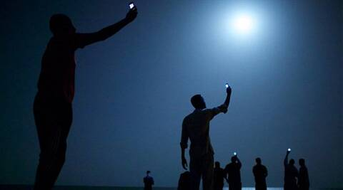 The World Press Photo of the Year 2013 by John Stanmeyer, USA, VII for National Geographic, shows African migrants on the shore of Djibouti city at night. ( AP Photo)