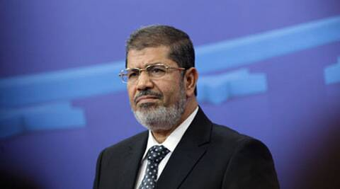 Morsi is accused of inciting the killing of opposition protesters outside the presidential palace in December 2012. (AP)