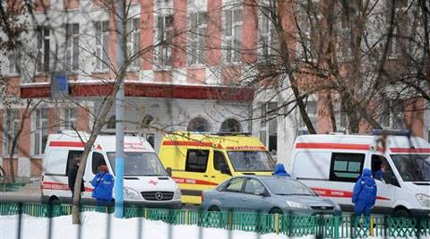 Moscow police said an armed teenager burst into the school and killed a security guard and a teacher before being taken into custody. (AP)