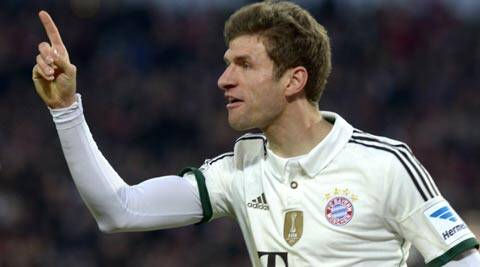 Bayern Munich's Thomas Mueller celebrates after scoring during the German Bundesliga first division soccer match against Hanover 96 (Reuters)