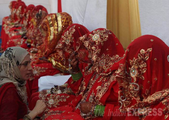 The brides wait for the ceremony at Y.M.CA ground before the marriage ceremony. (IE photo: Dilip Kagda)