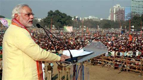 BJP PM candidate Narendra Modi addresses a rally at Brigade Parade Ground, Kolkata, Wednesday.