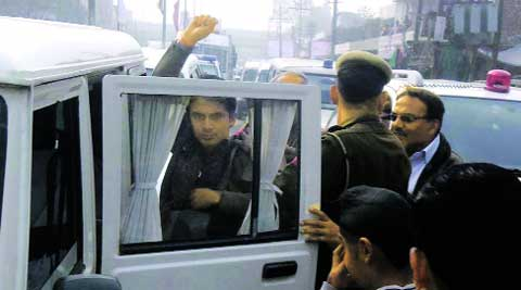 Kamal Mukhija is taken into custody after he allegedly slapped Hooda on Sunday.