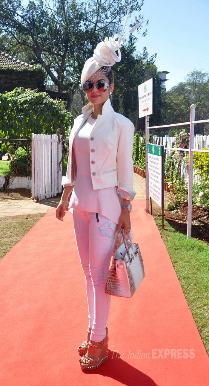 Natasha Poonawala is stylish in all white - trousers, top and fascinator. (Photo: Varinder Chawla)