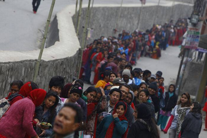 Devotees queue to offer a prayers during the Shivaratri festival at the courtyard of the Pashupatinath Hindu temple in Katmandu. (AP)