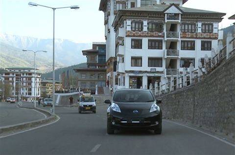 Nissan Motor Co., the Japanese automaker's electric car Leaf, right, runs in Thimphu in Bhutan