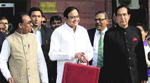 Finance minister P Chidambaram with ministers of state NN Meena and JD Seelam leaves for Parliament to present the Interim Budget 2014 on Monday. Ravi Kanojia