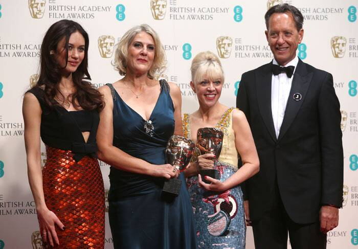 Winners of Best Production Design, Olga Kurylenko, Catherine Martyn, Beverley Dunn pose for pictures along with Richard E Grant. (Reuters)