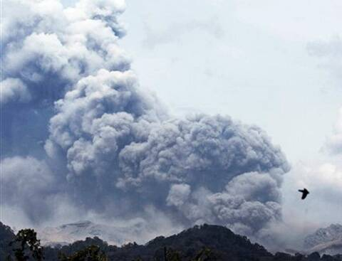 Mount Kelud erupts, as seen from Anyar village in Blitar, East Java, Indonesia, Friday, Feb. 14, 2014.