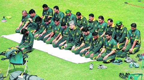 Team Pakistan observe their afternoon prayers before a practice session in Dhaka, on the eve of their Asia Cup opener against Sri Lanka.AP