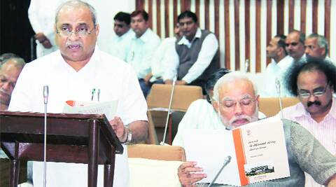 Finance Minister Nitin Patel presents the budget in the Assembly in Gandhinagar on Friday. Chief Minister Narendra Modi is also seen. (PTI)