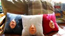 Emily King, 26, developed the pillow that comes with the lips of a cardiopulmonary resuscitation (CPR) dummy sewn into the centre.