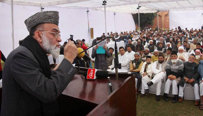 Shahi Imam of Delhi's Jama Masjid Maulana Syed Ahmed Bukhari addresses a convention on Lok Sabha elections, at the mosque in New Delhi on Saturday. (PTI)
