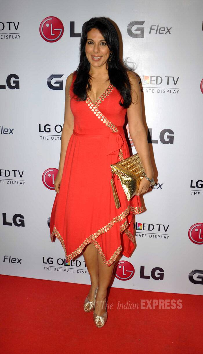 Pooja Bedi was all dressed up in a bright orange-red dress with gold peep-toes and matching clutch. (Photo: Varinder Chawla)