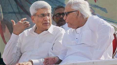 CPI(M) General Secretary,Prakash Karat and former West Bengal Chief Minister and CPI(M) Politburo member Buddhadeb Bhattacharya at Left Front rally in Kolkata. (PTI)