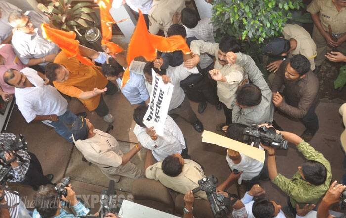 Wielding saffron flags and chanting 'Pakistanis go back' and 'Vande Mataram', Shiv Sena workers today barged into a press conference of a music band from Pakistan, heckled the artistes and vandalised the venue, police said. (IE Photo: Gaensh Shirsekar)