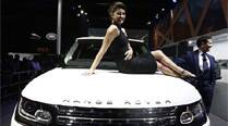 Bollywood actress Priyanka Chopra poses with Jaguar Land Rover's Range Rover LWB during its launch at the Indian Auto Expo 2014 in Greater Noida. (PTI)