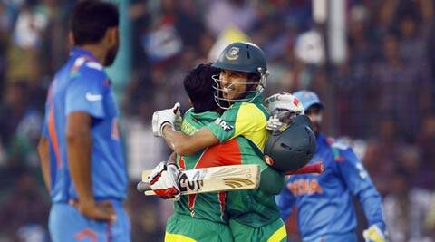 Bangladesh's Mushfiqur Rahim, center left, embraces teammate Nasir Hossain after scoring a century during the Asia Cup match against India (AP)