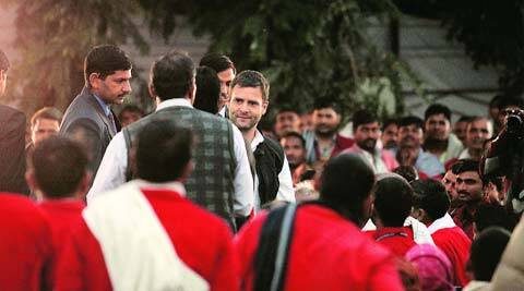 Rahul Gandhi talks to porters at the New Delhi railway station on Tuesday. (Tashi Tobgyal)