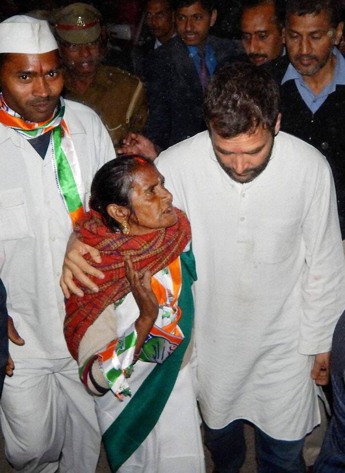 Congress Vice President Rahul Gandhi talks to an old lady during foundation stone laying ceremony of Rail Neer bottling plant at Gauriganj in Amethi, Uttar Pradesh. (PTI)
