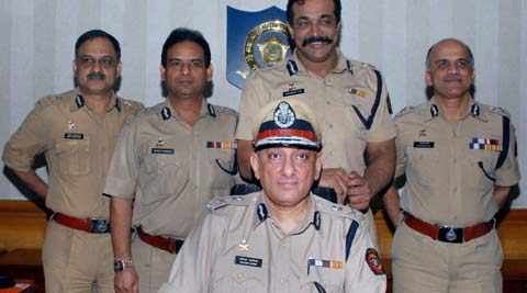 Rakesh Maria after being appointed as a Mumbai Police Commissioner in Mumbai on Sunday. Senior Police Officers also in picture. (PTI)