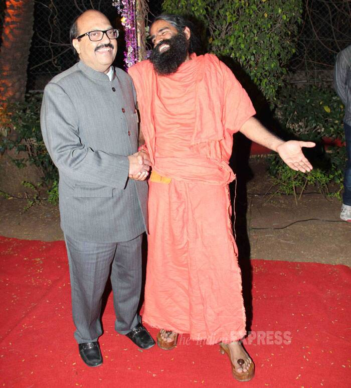 The yoga guru seemed to be having a good time as he socialised with former Samajwadi Party leader Amar Singh at the reception. (Photo: Varinder Chawla)
