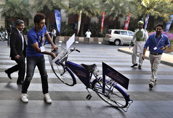 What is the Kapoor lad trying to do with the bicycle ? (AP)