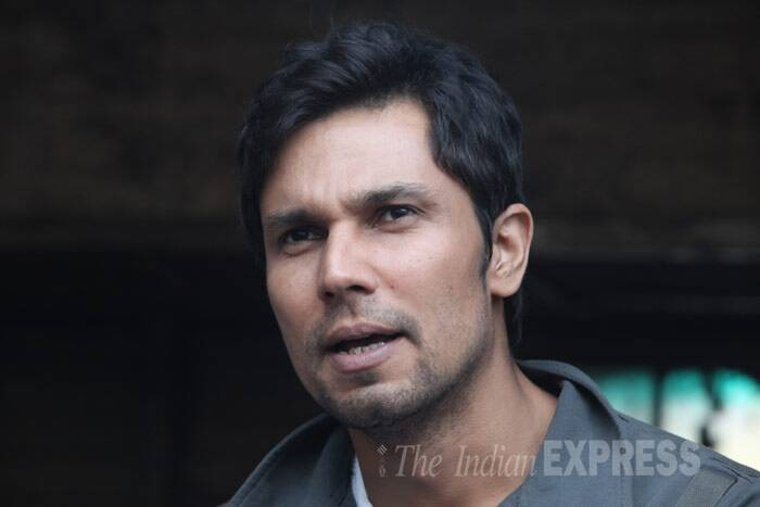 Randeep, who plays a truck driver in the movie, is in no mood to interact. (IE Photo: Dilip Kagda)