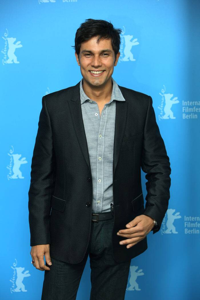 Randeep Hooda, who was last seen in 'John Day', seems tickled as he poses on the red carpet.