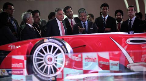 Ratan Tata looks through car models of Mahindra at the Auto Expo in Greater Noida. The company unveiled its concept electric sports car 'Halo' which it expects to launch commercially in the next three years. (IE Photo: Tashi Tobgyal)