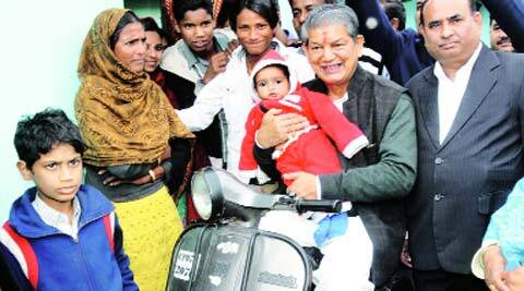 Rawat with citizens on one of his regular visits through town.