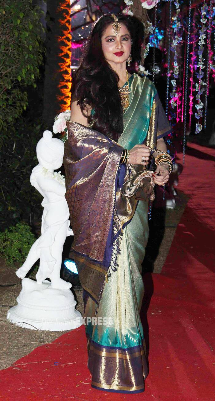 30. Rekha looks beautiful as ever in her signature Kanchivaram sari, side-swept hair and dark lip-colour. (Photo: Varinder Chawla)