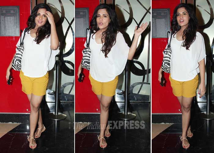'Fukrey' actress Richa Chadda, who looks sexy in yellow hot pants and white tee, throws a pap tantrum. (Photo: Varinder Chawla)