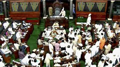 As soon as Lok Sabha met for the day, SP members rushed to the Well demanding passage of the Communal Violence Prevention Bill. (PTI)