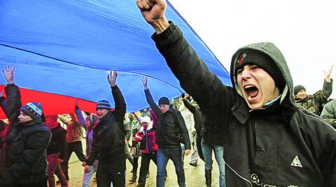 People march under a giant Russian flag during a pro-Russian rally in Simferopol, Crimea Thursday. (Reuters)