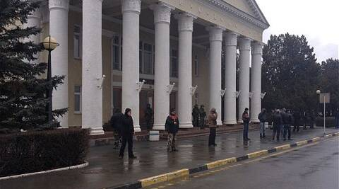Armed men guard Simferopol airport.