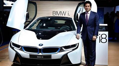 Sachin Tendulkar poses with a BMW i8 hybrid car at the 12th Indian auto Expo in Greater Noida. (AP)