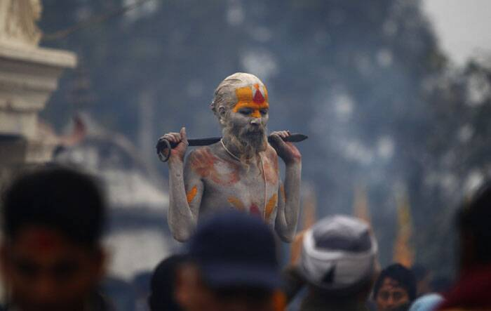A sadhu man poses for tourists during the 'Shivaratri' festival at the courtyard of the Pashupatinath Hindu temple in Katmandu. (AP)