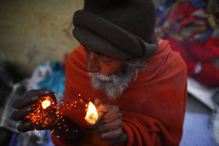 A sadhu smokes marijuana during the Shivaratri festival at the courtyard of the Pashupatinath Hindu temple in Katmandu, Nepal. <br /> Shivaratri, or the night of Shiva, is dedicated to the worship of Lord Shiva, the Hindu god of death and destruction. (AP)