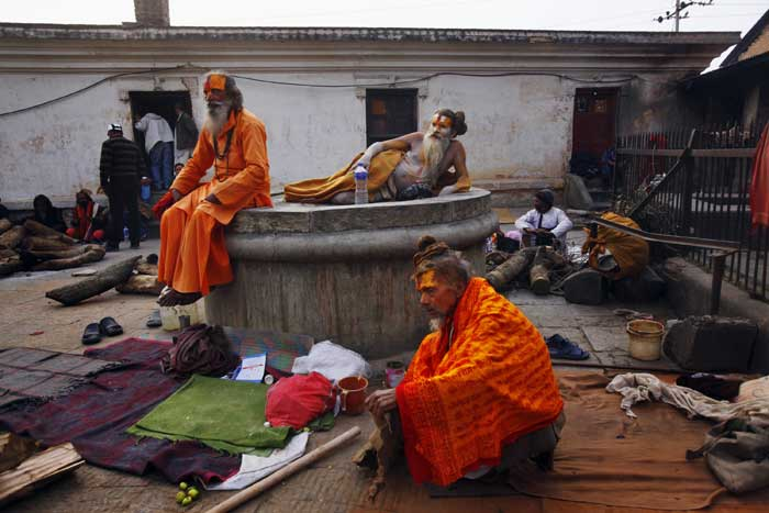 Sadhus rest in the courtyard of the Pashupatinath Temple in Katmandu. (AP)