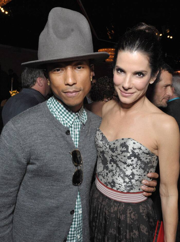 Pharrell Williams and Sandra Bullock at the 86th Oscars Nominees Luncheon. (AP)
