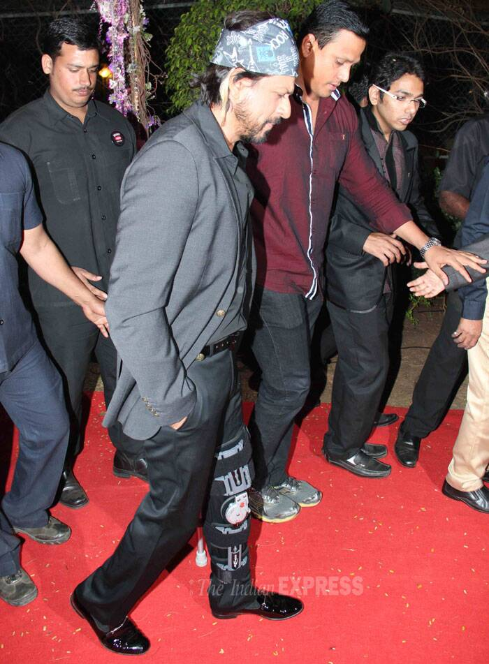 SRK, who recently got injured on the sets of Farah Khan's 'Happy New Year' made it a point to attend the reception, limps as he makes his way. (Photo: Varinder Chawla)