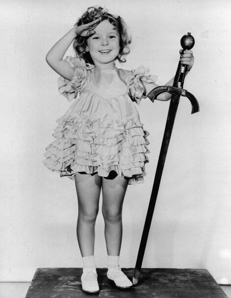 "In this 1933 file photo, child actress Shirley Temple is seen in her role as ""Little Miss Marker"". Shirley Temple, the curly-haired child star who put smiles on the faces of Depression-era moviegoers, has died. She was 85. (AP)"