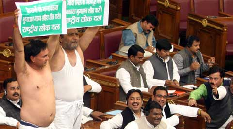 Rashtriya Lok Dal legislators Veerpal and Sudesh Sharma took out their 'kurtas' in protest against the SP government. (Express Photo: Vishal Srivastav)