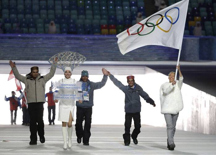 With the Indian Olympic Association (IOA) suspended by the International Olympic Committee (IOC) due to ethical and administrative reasons, luger Shiva Keshavan, Alpine skier Himanshu Thakur and cross-country skier Nadeem Iqbal will have to walk behind the IOC flag. Shiva Kesavan, an Independent Olympic Participant, third from left, arrives during the opening ceremony of the 2014 Winter Olympics in Sochi, Russia. (AP)